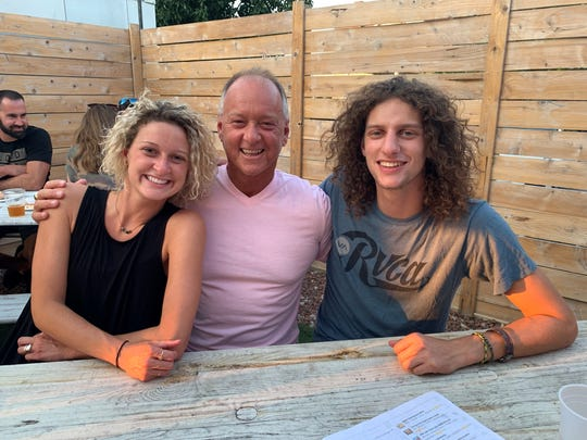 Gerrin Moore (right) was tested positive for COVID-19 while he was in Florida. Ally Moore (left) was stranded in an airport after visiting Barcelona. Their father, Jeffersonville Mayor Mike Moore (center), had to juggle both family and city matters regarding the coronavirus.