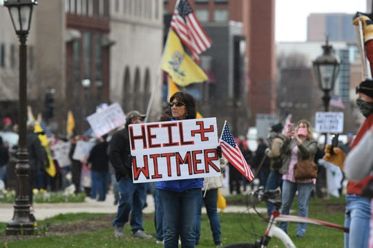 Participants at a protest against Michigan Gov. Gretchen Whitmer's stay-at-home order Wednesday, April 15, 2020, in downtown Lansing at the State Capitol.