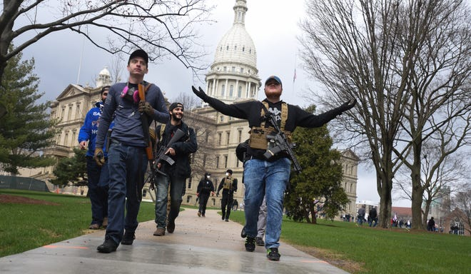 Rallygoers, including open-carry advocates protest against Michigan Gov. Gretchen Whitmer's stay-at-home order Wednesday, April 15, 2020, in downtown Lansing, Mich. near the State Capitol. [MATTHEW DAE SMITH/USA Today Network]