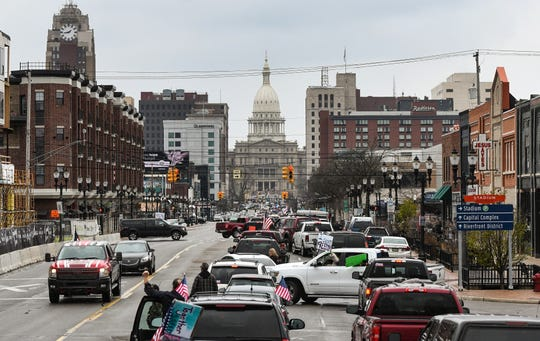 Demonstrators rally near the Michigan State Capitol in downtown Lansing, against Michigan Gov. Gretchen Whitmer's stay-at-home order Wednesday, April 15, 2020.