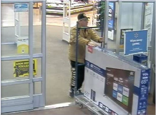Mansfield police say this individual purchased a TV using counterfeit money.