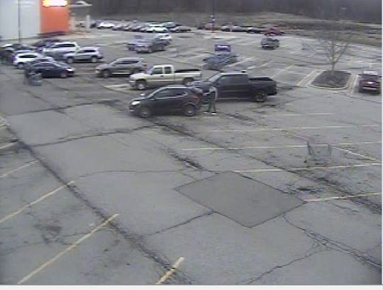 Mansfield police say a TV bought with counterfeit money was loaded into the car pictured.