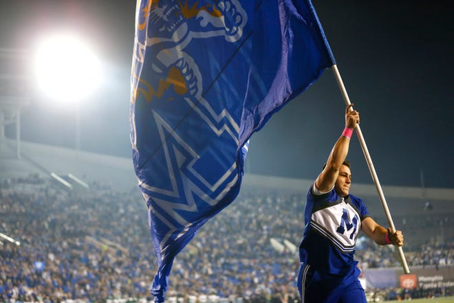 Oct. 19, 2019 - A University of Memphis cheerleader celebrates a touchdown against Tulane during a game at the Liberty Bowl Memorial Stadium.