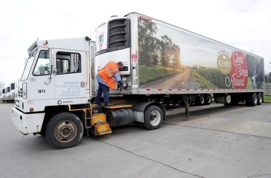 Tom Kopak, with Kemps, hooks up a trailer before backing it into a dock at the company in Cedarburg on Wednesday, April 15, 2020. The nonprofit Hunger Task Force says it will commit up to $1 million to a newly created Wisconsin Dairy Recovery Program aimed at helping farmers and food pantries.