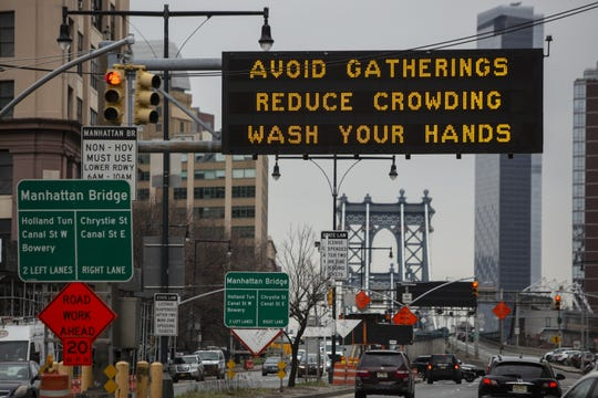 NEW YORK, NY - MARCH 19: A sign warns residents to take steps to contol the outbreak at the entrance to the Manhattan Bridge in Brooklyn as the Coronavirus, COVID19, outbreak continued unabated on March 19, 2020 in New York City. The economic situation in the city continued to decline as more businesses closed their doors and New York weighed a shelter in place order for the entire city. (Photo by Victor J. Blue/Getty Images)