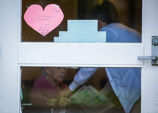 "A heart shaped sign taped to an exterior door at Morrison Woods Health Campus reads ""We love you to the moon and back!"" Wednesday, April 15, 2020."