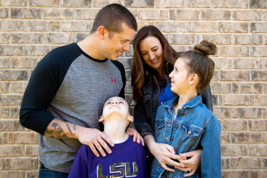 Ben and April DiChiara pose for a photo with their children, Tag, 7, and Sophia, 10, at their home Wednesday, April 15, 2020, in Spring Hill.