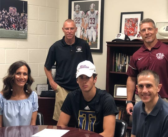 First Baptist Academy senior Peyton Urbancic signs a letter of intent to play basketball at the University of Tulsa during a small ceremony at his school on Wednesday, April 15, 2020.