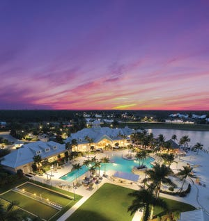 Naples Reserve Island Club shown at sunset.