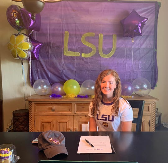 Gulf Coast High School swimmer Brooke Boling signs a letter of intent to swim at LSU on Wednesday, April 15, 2020, at her home.