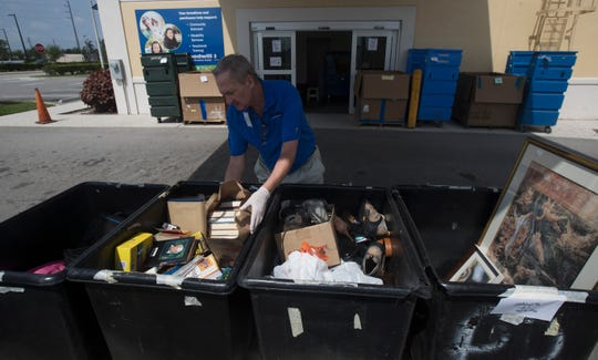 Mark Carpenter an employee of the Goodwill Store at Heritage Bay in North Naples sorts donated items on Wednesday, April 15, 2020.