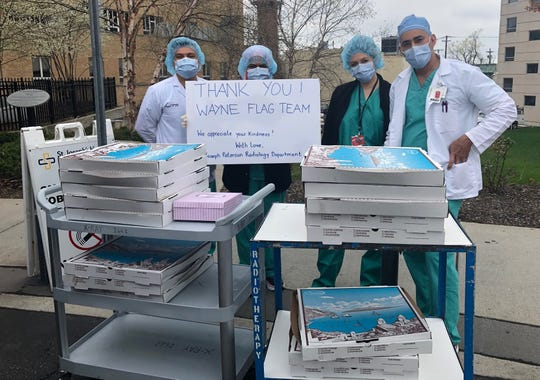 Nurses at St. Joseph's University Medical Center in Paterson receive donated meals from Front Line Appreciation Group of Greater Wayne on April 9.