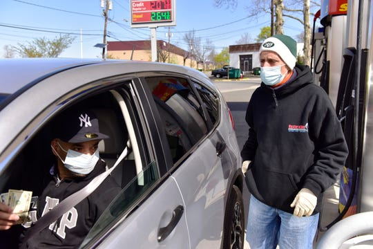 Mike Lane, a gas station attendant, tries to protect himself the best way he can to avoid the coronavirus while working at a Sunoco in Ridgefield Park, N.J. on Wednesday April 15, 2020.