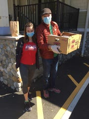 Jacqueline Murphy and Demitri Malki, owner of De Novo European Pub in Montclair, loaded meals to take to to the staff at Clara Maass Medical Center.