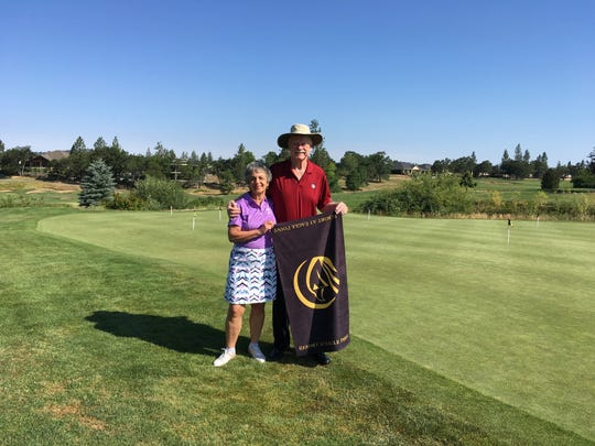 New Jersey's Emily and Jim Mangam celebrate in Oregon in the summer of 2019 after completing a 20-year quest to play at least one round of golf in all 50 states.