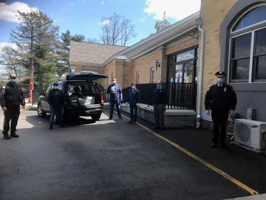 Feed the Front Line volunteers delivered food and drink from Roma Pizza on Main Street to the N.J. Firemen's Home in Boonton, where staff and residents have been sickened by the coronavirus outbreak. April 15, 2020.