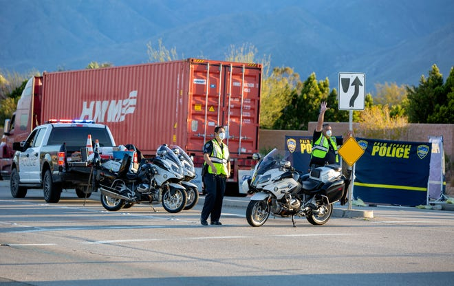 Palm Springs Police divert traffic off of Gene Autry Trail at Via Escuela in Palm Springs, Calif., as they investigate a fatality on Tuesday, April 14, 2020.