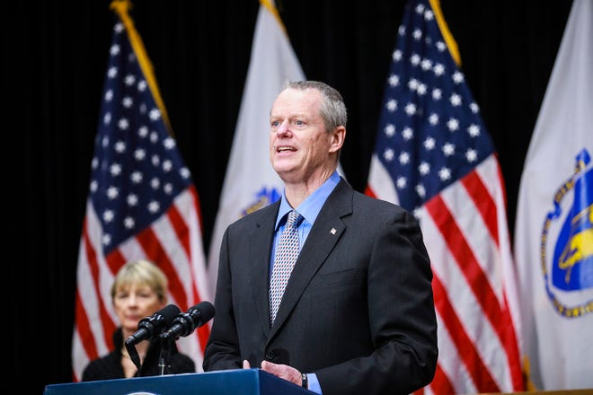 In this April 3, 2020, file photo, Secretary of Health and Human Services Marylou Sudders, left, joins Massachusetts Gov. Charlie Baker for a press conference providing an update on coronavirus cases in the state, at the Massachusetts State House in Boston.