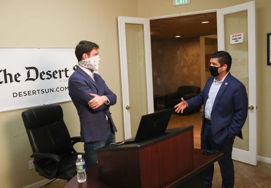 Rep. Raul Ruiz, left, and Desert Sun reporter Mark Olalde speak in person after participating in a Q&A conference call about the coronavirus in Palm Desert, April 15, 2020.
