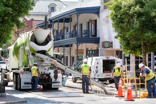 Crews work on the Gulf Power underground energy upgrade project along Palafox Place in  downtown Pensacola on Tuesday, April 14, 2020.  Work is progressing faster with less traffic due to the coronavirus shutdown.
