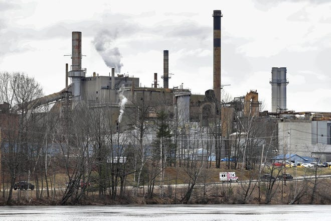 An ambulance arrives at the Androscoggin Mill after an explosion at the paper mill, Wednesday, April 15, 2020, in Jay, Maine. The explosion shook the ground and produced a plume of black smoke that was visible for miles around.
