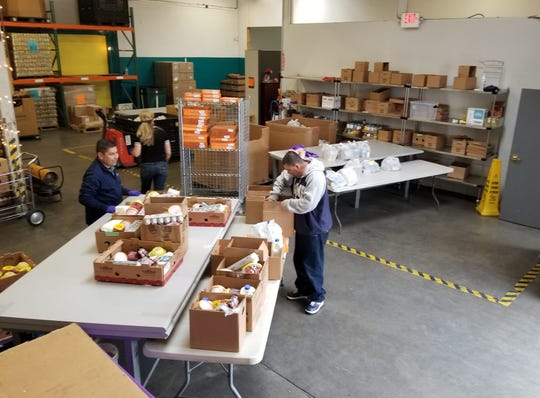 Boxes of food are packed for St. Vincent's Food Pantry of Reno, which serves more than 15,000 people a month.