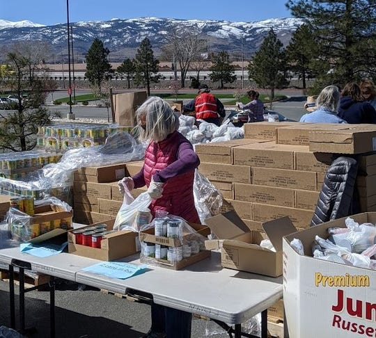Volunteers pack food for the Food Bank of Northern Nevada Mobile Harvest that distributes food monthly at locations throughout Northern Nevada.