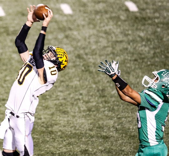 Menard's Grant Emmons intercepts a pass in the Yellow Jackets' first-round playoff win over Eldorado in 2015.