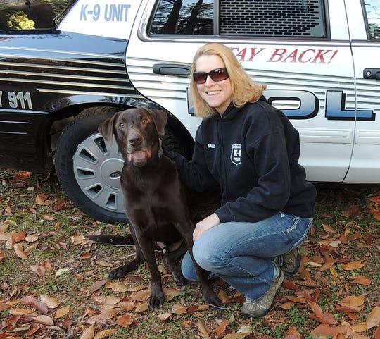 Sheboygan police dog Bud with his partner, Officer Trisha Saeger.