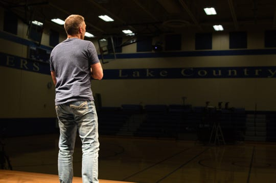 Senior Pastor Jeff Jaeger preaches to an empty gym during Crossroads Community Church's Good Friday service.