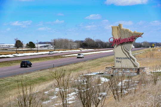 A sign welcomes travelers crossing the border from South Dakota to Minnesota on Wednesday, April 15, on Interstate 90.