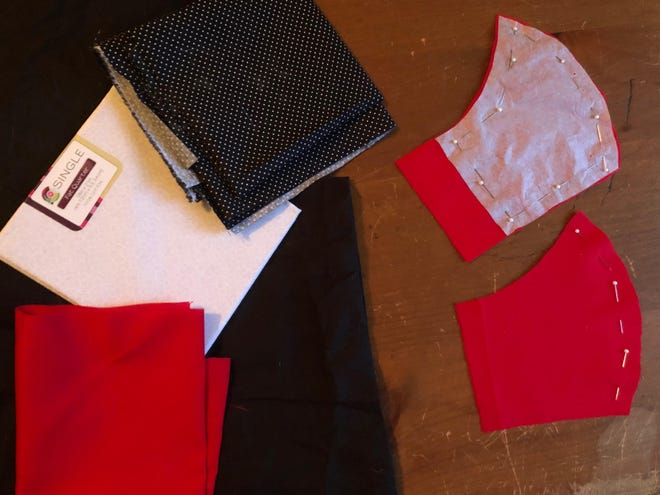 Ashley Showalter taught herself how to sew by hand. She uses pillowcases, fabric squares and hairbands as material to make cloth masks for COVID-19 protection.
