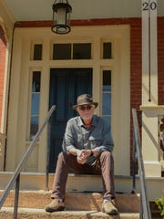 Dennis Ward sits on the steps of his home in Staunton for a photograph that is part of the Front Steps Project.