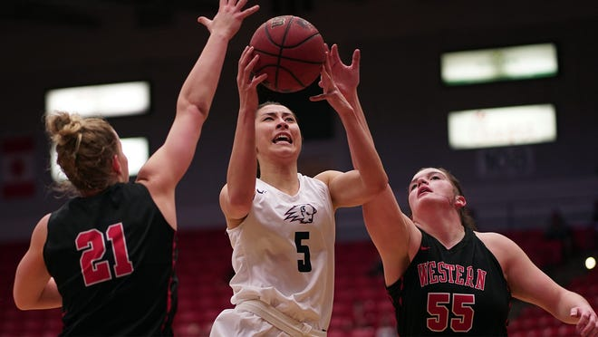 Former Dixie State women's basketball player Lisa VanCampen (5) was a beloved Trailblazer teammate. She passed away on April 12.