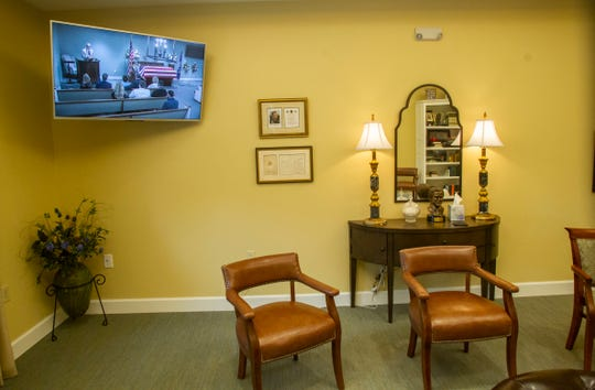 Funeral services are shown on a television in a separate room to allow for more friends and family to attend a service.