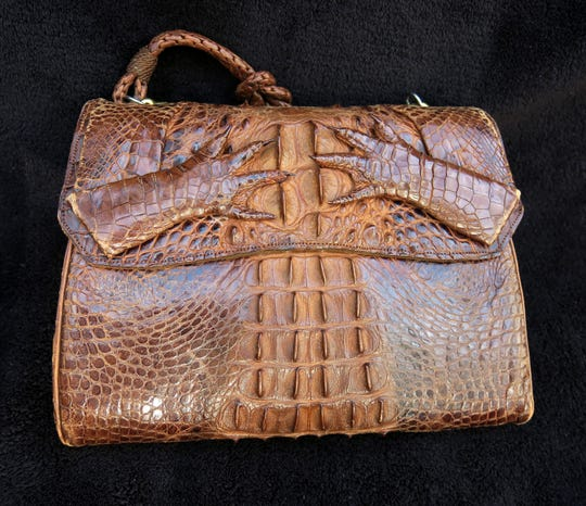 An alligator skin purse, circa 1930s.