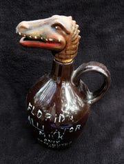 Alligator head souvenir mug.