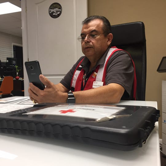Enrique Rivero, a Red Cross Disaster Action Team member, responds to a home fire remotely and using video conferencing technology to serve a family in need.