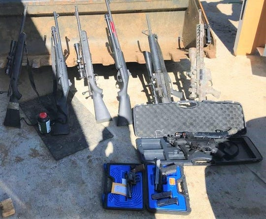 Various firearms seized during a search warrant at a Lockwood Valley residence on Monday.