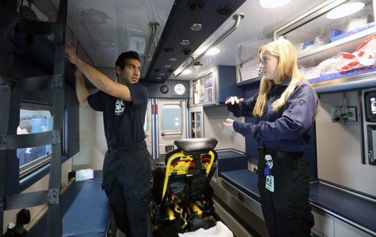 Harpur's Ferry Student Volunteer Ambulance Service EMTs Niraj Sha and Eliana Shaskar check out the supplies in an ambulance at Stony Point Ambulance Corps April 15, 2020. The SUNY Binghamton students are part of a group who are helping out Ambulance Corps in Rockland County during the coronavirus outbreak.