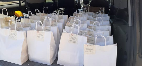 Lunch bags filled with boxed meals for first responders, a new program launched by Dubrovnik Restaurant in New Rochelle.