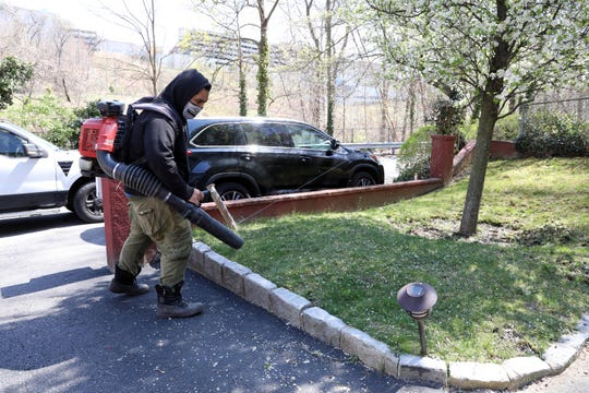 Jesus Cruz of Paramount Landscaping uses a leaf blower at a clients home in Yonkers April 15, 2020. Cruz said that most of his clients are in Yonkers, where there hasn't been any restrictions on using leaf blowers, but checks daily.