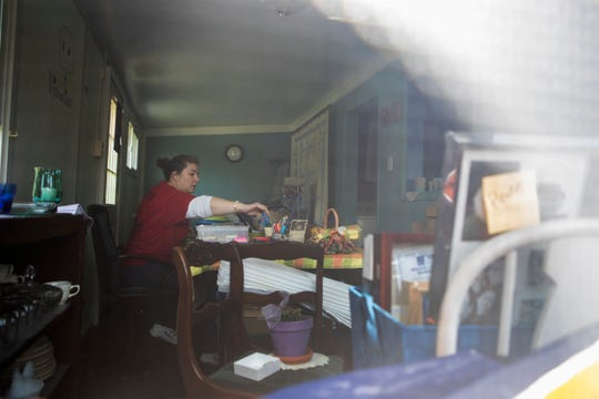 Stephanie Hart, a fourth grade teacher New Castle Elementary School, works at her makeshift classroom office at her home Wednesday afternoon.