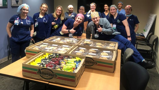 The ICU staff at ChristianaCare's Wilmington Hospital gets ready to enjoy some of the 200 free meals provided by the Delaware Wrestling Alliance on Tuesday.