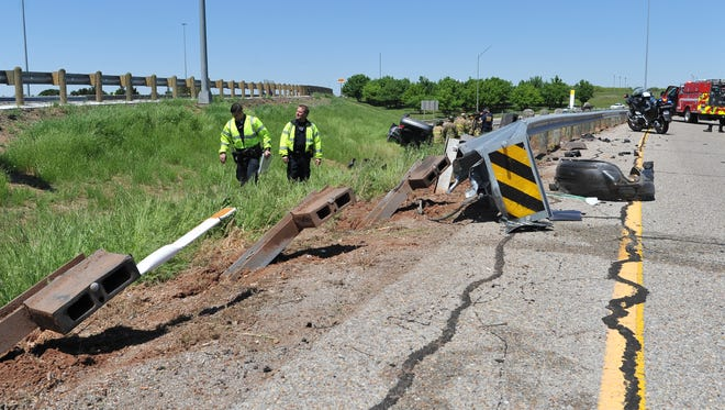 Wichita Falls police and firefighters work the scene of a pin-in accident on Spur 325 near Central Freeway.