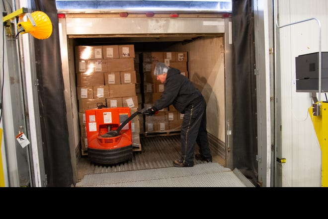 As of April 15, 8.500 pounds of shredded cheese headed to Ruby's Pantry, which contacted Burnett Dairy Cooperative saying the food pantry needed dairy products. Pictured is Michael Robin, Burnett Dairy warehouse assistant, loading cheese into a refrigerated truck.