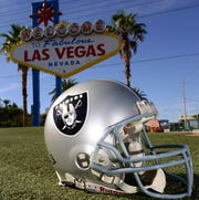 """May 11, 2016; Las Vegas, NV, USA; General view of Oakland Raiders helmet at the """"Welcome to Fabulous Las Vegas"""" sign on the Las Vegas strip on Las Vegas Blvd."""