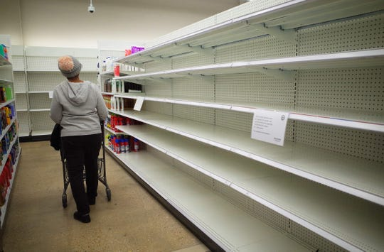 Shelves are empty of cleaning supplies at a shop in Washington, DC on March 22, 2020. Baby formula is one of many items consumers are struggling to find in supermarkets around the US.