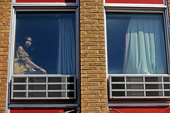 Yifan Jin, 18, a student at the Wisconsin International Academy in Wauwatosa, Wi., looks out one of the dorm windows on Monday, April 13, 2020. Hundreds of thousands of Chinese nationals are in the United States for secondary and college education.
