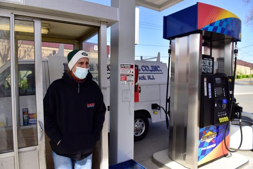 Mike Lane, a gas station attendant, tries to protect himself the best way he can to avoid the coronavirus while working at a Sunoco in Ridgefield Park, N.J. on April 15, 2020.  NJ is the only state with full service gas in the country.